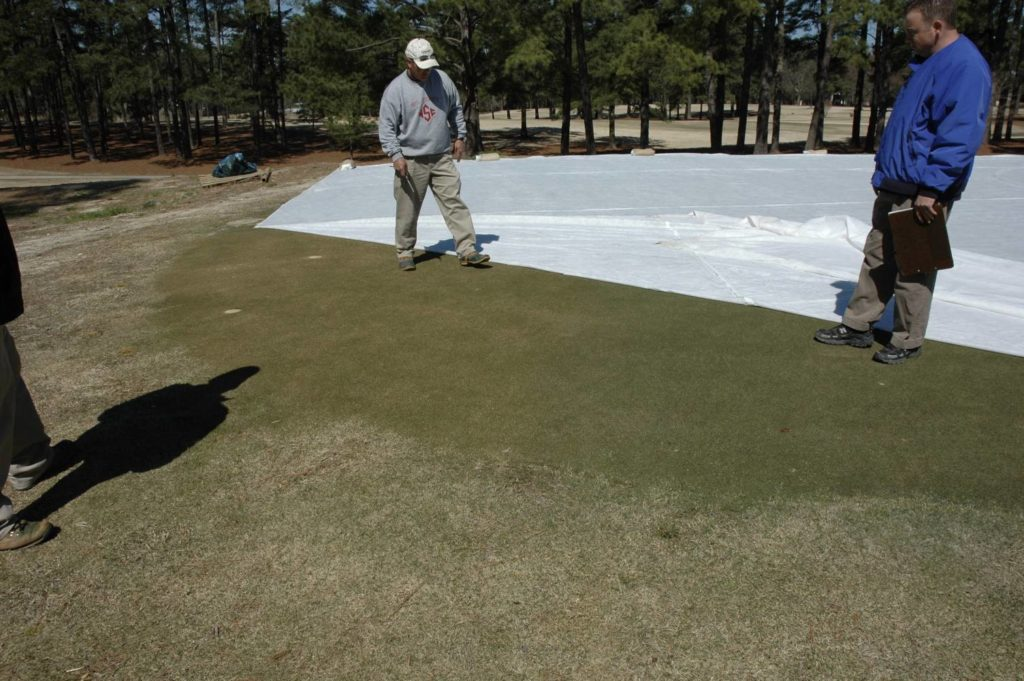 Turfgrass professionals taking a peek under the covers